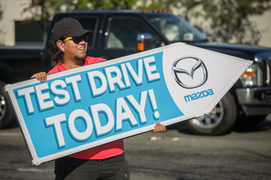 AArrow Sign Spinners Spin For Mazda, Test Drive Today