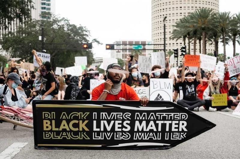 Rayshod sitting in at a Black Lives Matter demonstration in Tampa