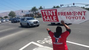 Toyota Dealership Sign Holding
